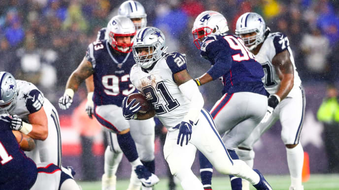 FOXBOROUGH, MA - NOVEMBER 24: Ezekiel Elliott #21 of the Dallas Cowboys runs with the ball during a game against the New England Patriots at Gillette Stadium on November 24, 2019 in Foxborough, Massachusetts. (Photo by Adam Glanzman/Getty Images)