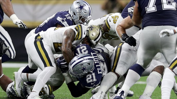 NEW ORLEANS, LOUISIANA - SEPTEMBER 29: Ezekiel Elliott #21 of the Dallas Cowboys dives against the New Orleans Saints during the second quarter in the game at Mercedes Benz Superdome on September 29, 2019 in New Orleans, Louisiana. (Photo by Chris Graythen/Getty Images)