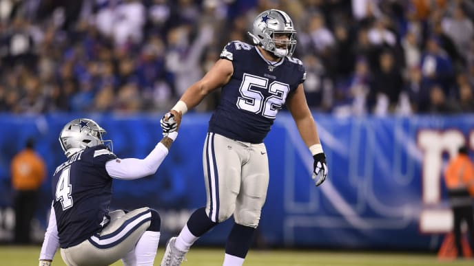EAST RUTHERFORD, NEW JERSEY - NOVEMBER 04: Connor Williams #52 helps Dak Prescott #4 of the Dallas Cowboys off the ground during the second quarter of the game against the New York Giants at MetLife Stadium on November 04, 2019 in East Rutherford, New Jersey. (Photo by Sarah Stier/Getty Images)