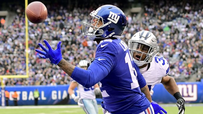 EAST RUTHERFORD, NEW JERSEY - DECEMBER 30:  Cody Latimer #12 of the New York Giants makes a second quarter touchdown reception while defended by Byron Jones #31 of the Dallas Cowboys at MetLife Stadium on December 30, 2018 in East Rutherford, New Jersey. (Photo by Steven Ryan/Getty Images)