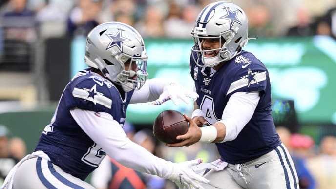 EAST RUTHERFORD, NEW JERSEY - OCTOBER 13: Dak Prescott #4 of the Dallas Cowboys hands the ball off to Ezekiel Elliott #21 against the New York Jets during the first quarter at MetLife Stadium on October 13, 2019 in East Rutherford, New Jersey. (Photo by Steven Ryan/Getty Images)