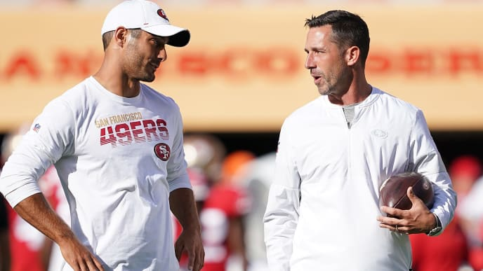 SANTA CLARA, CA - AUGUST 10:  Quarterback Jimmy Garoppolo #10 and head coach Kyle Shanahan of the San Francisco 49ers talk with each other during pregame warm ups prior to the start of an NFL preseason football game against the Dallas Cowboys at Levi's Stadium on August 10, 2019 in Santa Clara, California.  (Photo by Thearon W. Henderson/Getty Images)