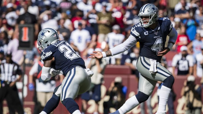 LANDOVER, MD - SEPTEMBER 15: Dak Prescott #4 of the Dallas Cowboys hands the ball off to Ezekiel Elliott #21 against the Washington Redskins during the second half at FedExField on September 15, 2019 in Landover, Maryland. (Photo by Scott Taetsch/Getty Images)