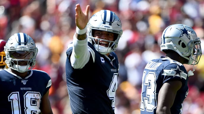 LANDOVER, MD - SEPTEMBER 15: Dak Prescott #4 of the Dallas Cowboys celebrates a first down against the Washington Redskins during the first half at FedExField on September 15, 2019 in Landover, Maryland. (Photo by Will Newton/Getty Images)