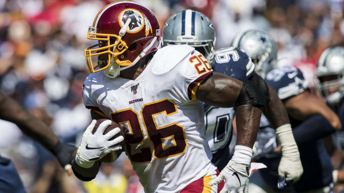 LANDOVER, MD - SEPTEMBER 15: Adrian Peterson #26 of the Washington Redskins carries the ball against the Dallas Cowboys during the first half at FedExField on September 15, 2019 in Landover, Maryland. (Photo by Scott Taetsch/Getty Images)
