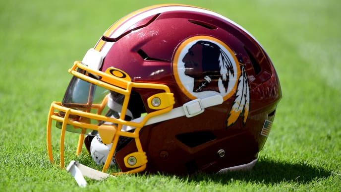 LANDOVER, MD - SEPTEMBER 15: A detailed view of a Washington Redskins football helmet on the field prior to the game between the Washington Redskins and the Dallas Cowboys at FedExField on September 15, 2019 in Landover, Maryland. (Photo by Will Newton/Getty Images)