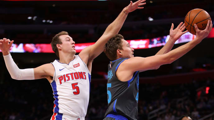 DETROIT, MICHIGAN - JANUARY 31:  Ryan Broekhoff #45 of the Dallas Mavericks drives to the basket past Luke Kennard #5 of the Detroit Pistons during the first half at Little Caesars Arena on January 31, 2019 in Detroit, Michigan. NOTE TO USER: User expressly acknowledges and agrees that, by downloading and or using this photograph, User is consenting to the terms and conditions of the Getty Images License Agreement. (Photo by Gregory Shamus/Getty Images)