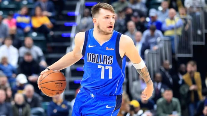 INDIANAPOLIS, IN - JANUARY 19:  Luka Doncic #77 of the Dallas Mavericks dribbles the ball against the  Indiana Pacers at Bankers Life Fieldhouse on January 19, 2019 in Indianapolis, Indiana.   NOTE TO USER: User expressly acknowledges and agrees that, by downloading and or using this photograph, User is consenting to the terms and conditions of the Getty Images License Agreement.  (Photo by Andy Lyons/Getty Images)