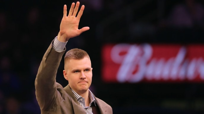 NEW YORK, NY - MARCH 13:  (EDITOR'S NOTE: Alternate crop) Kristaps Porzingis of the New York Knicks is welcomed back after tearing his ACL previously in the season prior to taking on the Dallas Mavericks during their game at Madison Square Garden on March 13, 2018 in New York City. NOTE TO USER: User expressly acknowledges and agrees that, by downloading and or using this photograph, User is consenting to the terms and conditions of the Getty Images License Agreement.  (Photo by Abbie Parr/Getty Images)