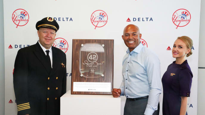 NEW YORK, NEW YORK - JULY 16: Delta Air Lines Pilot Chris Nevins, Former New York Yankees pitcher and unanimous Hall of Fame selection Mariano Rivera and Delta Air Lines Flight Attendant Katie Fow attend as Delta Air Lines dedicates gate 42 at JFK airport and 757 aircraft to Mariano Rivera before Hall of Fame Induction on July 16, 2019 at JFK airport in New York City. (Photo by Astrid Stawiarz/Getty Images for Delta Air Lines)