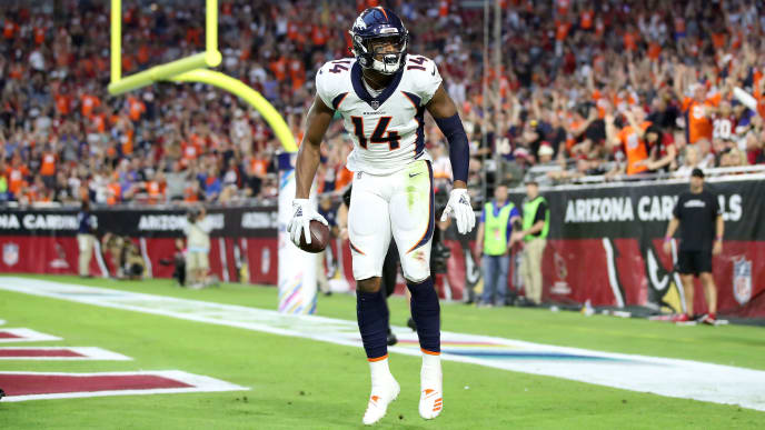GLENDALE, AZ - OCTOBER 18:  Wide receiver Courtland Sutton #14 of the Denver Broncos reacts after scoring a 28-yard touchdown during the first quarter against the Arizona Cardinals at State Farm Stadium on October 18, 2018 in Glendale, Arizona.  (Photo by Christian Petersen/Getty Images)