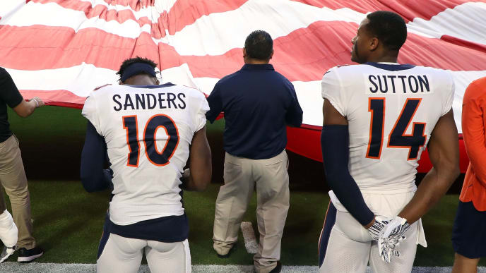 GLENDALE, AZ - OCTOBER 18: Offensive tackle Billy Turner #77, wide receiver Emmanuel Sanders #10 and wide receiver Courtland Sutton #14 of the Denver Broncos stand for the National Anthem before the game against the Arizona Cardinals at State Farm Stadium on October 18, 2018 in Glendale, Arizona. (Photo by Christian Petersen/Getty Images)