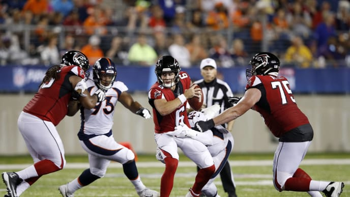 CANTON, OH - AUGUST 01: Kurt Benkert #6 of the Atlanta Falcons gets pressured while trying to pass in the second half of a preseason game against the Denver Broncos at Tom Benson Hall Of Fame Stadium on August 1, 2019 in Canton, Ohio. (Photo by Joe Robbins/Getty Images)