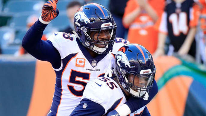 CINCINNATI, OH - DECEMBER 2:  Bradley Chubb #55 of the Denver Broncos is congratulated by Von Miller #58 after recovering a fumble during the fourth quarter of the game against the Cincinnati Bengals at Paul Brown Stadium on December 2, 2018 in Cincinnati, Ohio. Denver defeated Cincinnati 24-10. (Photo by Andy Lyons/Getty Images)