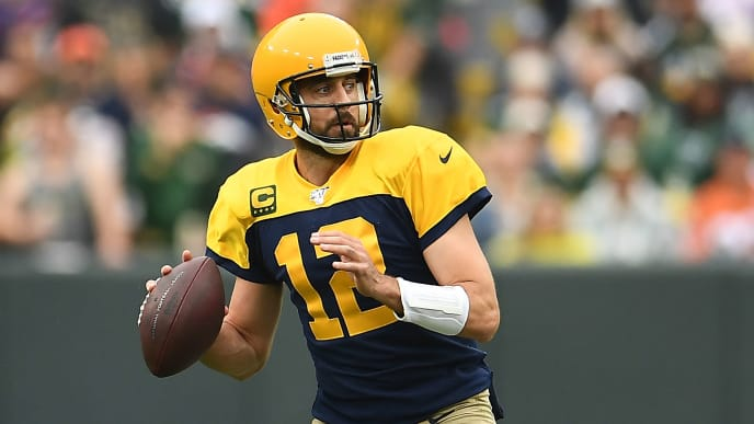 GREEN BAY, WISCONSIN - SEPTEMBER 22:  Aaron Rodgers #12 of the Green Bay Packers looks to pass during the first half against the Denver Broncos at Lambeau Field on September 22, 2019 in Green Bay, Wisconsin. (Photo by Stacy Revere/Getty Images)