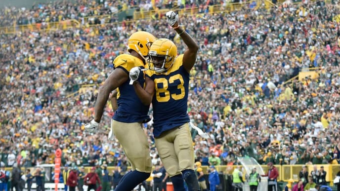 GREEN BAY, WISCONSIN - SEPTEMBER 22: Marquez Valdes-Scantling #83 of the Green Bay Packers score a touchdown in the first quarter against Kareem Jackson #22 of the Denver Broncos at Lambeau Field on September 22, 2019 in Green Bay, Wisconsin. (Photo by Quinn Harris/Getty Images)