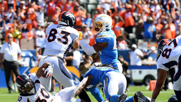 CARSON, CALIFORNIA - OCTOBER 06:  Phillip Lindsay #30 of the Denver Broncos falls into the endzone to score a touchdown, to take a 7-0 lead over the Los Angeles Chargers, during the first quarter at Dignity Health Sports Park on October 06, 2019 in Carson, California. (Photo by Harry How/Getty Images)