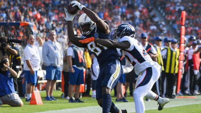 CARSON, CA - NOVEMBER 18: Wide receiver Mike Williams #81 of the Los Angeles Chargers makes a catch in front of defensive back Tramaine Brock #22 of the Denver Broncos for a first down in the second quarter at StubHub Center on November 18, 2018 in Carson, California. (Photo by Harry How/Getty Images)