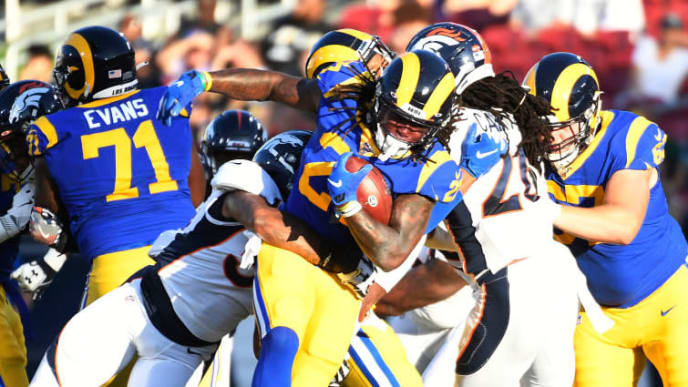 LOS ANGELES, CA - AUGUST 24: Running back Darrell Henderson #27 of the Los Angeles Rams breaks tackles during the first half of the pre season football game against Denver Broncos at Los Angeles Memorial Coliseum on August 24, 2019 in Los Angeles, California. (Photo by Kevork Djansezian/Getty Images)