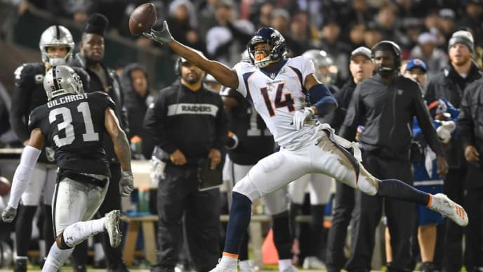 OAKLAND, CA - DECEMBER 24:  Courtland Sutton #14 of the Denver Broncos watches the pass go off his fingertips against the Oakland Raiders during the first half of their NFL football game at Oakland-Alameda County Coliseum on December 24, 2018 in Oakland, California.  (Photo by Thearon W. Henderson/Getty Images)