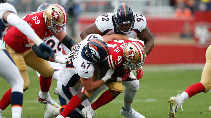 SANTA CLARA, CA - DECEMBER 09: Jeff Wilson #41 of the San Francisco 49ers is tackled by Josey Jewell #47 and Zach Kerr #92 of the Denver Broncos during their game at Levi's Stadium on December 9, 2018 in Santa Clara, California. (Photo by Lachlan Cunningham/Getty Images)