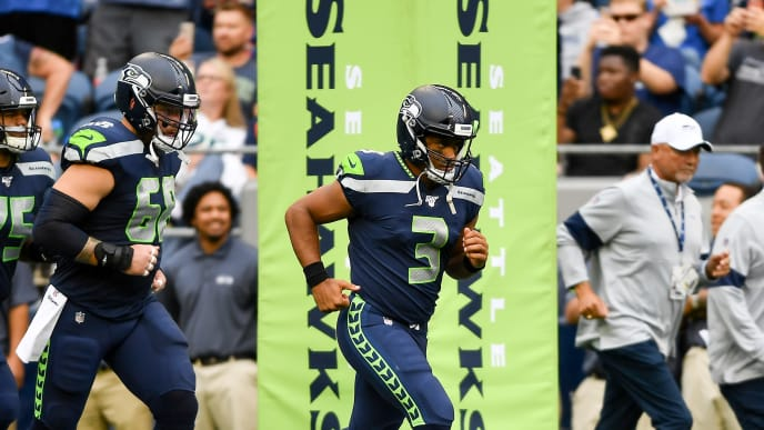 SEATTLE, WASHINGTON - AUGUST 08: Russell Wilson #3 of the Seattle Seahawks runs onto the field before the preseason game against the Denver Broncos at CenturyLink Field on August 08, 2019 in Seattle, Washington. (Photo by Alika Jenner/Getty Images)