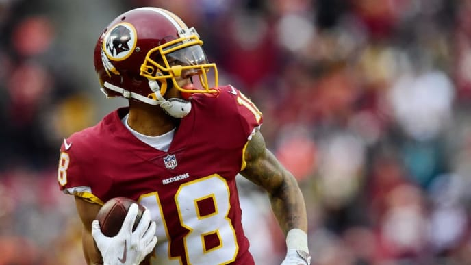 LANDOVER, MD - DECEMBER 24: Wide receiver Josh Doctson #18 of the Washington Redskins scores a touchdown against the Denver Broncos in the fourth quarter at FedExField on December 24, 2017 in Landover, Maryland. (Photo by Patrick McDermott/Getty Images)