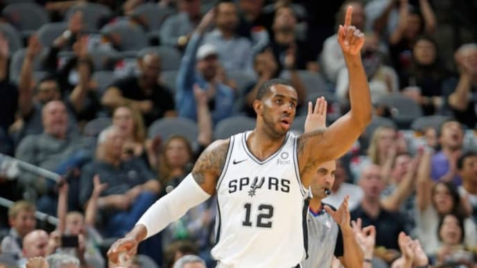 SAN ANTONIO, TX - APRIL 25:  LaMarcus Aldridge #12 of the San Antonio Spurs receives celebration from bench and fans after scoring against the Denver Nuggets during Game Six of the first round of the 2019 NBA Western Conference Playoffs at AT&T Center on April 25, 2019 in San Antonio, Texas.  NOTE TO USER: User expressly acknowledges and agrees that, by downloading and or using this photograph, User is consenting to the terms and conditions of the Getty Images License Agreement. (Photo by Ronald Cortes/Getty Images)