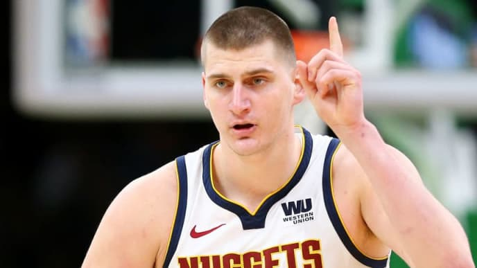 BOSTON, MASSACHUSETTS - MARCH 18: Nikola Jokic #15 of the Denver Nuggets celebrates after scoring against the Boston Celtics during the second half at TD Garden on March 18, 2019 in Boston, Massachusetts. The Nuggets defeat the Celtics 114-105. NOTE TO USER: User expressly acknowledges and agrees that, by downloading and or using this photograph, User is consenting to the terms and conditions of the Getty Images License Agreement.  (Photo by Maddie Meyer/Getty Images)