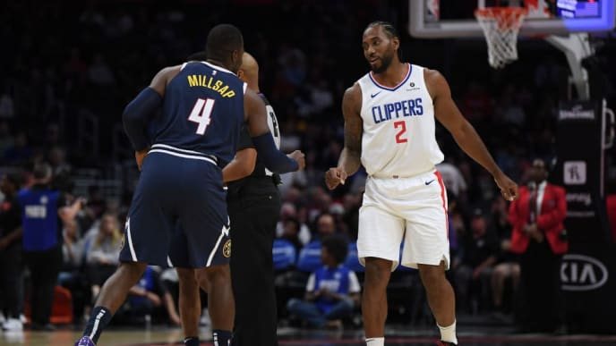 LOS ANGELES, CALIFORNIA - OCTOBER 10:  Kawhi Leonard #2 of the LA Clippers greets Paul Millsap #4 of the Denver Nuggets before a preseason game at Staples Center on October 10, 2019 in Los Angeles, California. (Photo by Harry How/Getty Images)