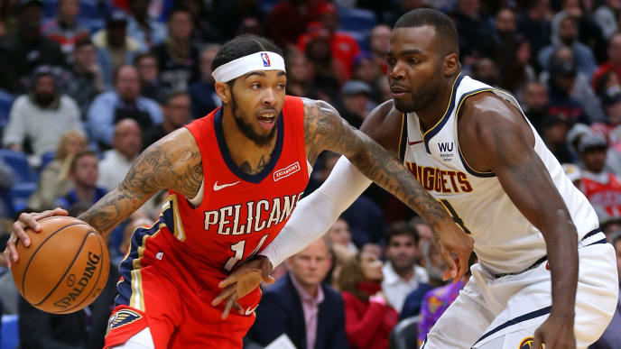 NEW ORLEANS, LOUISIANA - OCTOBER 31: Brandon Ingram #14 of the New Orleans Pelicans drives against Paul Millsap #4 of the Denver Nuggets during the first half of a game at the Smoothie King Center on October 31, 2019 in New Orleans, Louisiana. NOTE TO USER: User expressly acknowledges and agrees that, by downloading and or using this Photograph, user is consenting to the terms and conditions of the Getty Images License Agreement.  (Photo by Jonathan Bachman/Getty Images)
