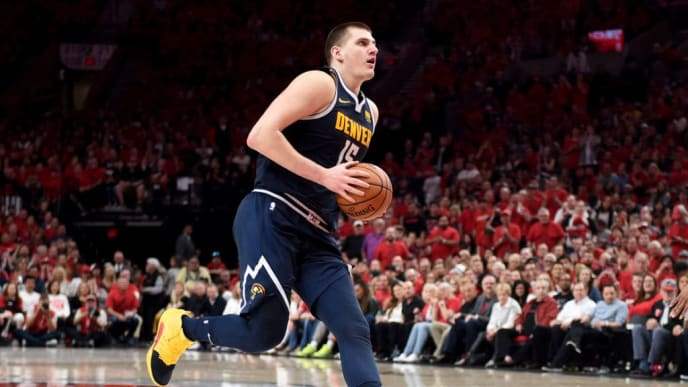 PORTLAND, OREGON - MAY 05: Nikola Jokic #15 of the Denver Nuggets drives to the basket during the second half of game four of the Western Conference Semifinals against the Portland Trail Blazersat Moda Center on May 05, 2019 in Portland, Oregon. The Nuggets won 116-112. NOTE TO USER: User expressly acknowledges and agrees that, by downloading and or using this photograph, User is consenting to the terms and conditions of the Getty Images License Agreement. (Photo by Steve Dykes/Getty Images)