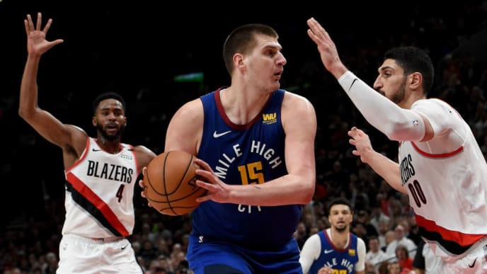 PORTLAND, OREGON - MAY 09: Nikola Jokic #15 of the Denver Nuggets looks to pass the ball on Enes Kanter #00 as Maurice Harkless #4 of the Portland Trail Blazers closes in during the second half of Game Six of the Western Conference Semifinals at Moda Center on May 09, 2019 in Portland, Oregon. The Blazers won 119-108. NOTE TO USER: User expressly acknowledges and agrees that, by downloading and or using this photograph, User is consenting to the terms and conditions of the Getty Images License Agreement. (Photo by Steve Dykes/Getty Images)