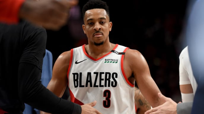 PORTLAND, OREGON - MAY 09: CJ McCollum #3 of the Portland Trail Blazers is greeted as he heads bcak to the bench after hitting a shot during the second half of Game Six of the Western Conference Semifinals Denver Nuggets at Moda Center on May 09, 2019 in Portland, Oregon. The Blazers won 119-108. NOTE TO USER: User expressly acknowledges and agrees that, by downloading and or using this photograph, User is consenting to the terms and conditions of the Getty Images License Agreement. (Photo by Steve Dykes/Getty Images)
