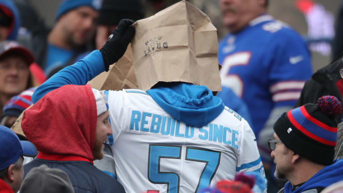 BUFFALO, NY - DECEMBER 16: A fan of the Detroit Lions wears a paper bag over his head and a jersey referencing the team's most recent NFL championship to show his frustration with the team's performance during NFL game action against the Buffalo Bills at New Era Field on December 16, 2018 in Buffalo, New York. (Photo by Tom Szczerbowski/Getty Images) *** Local Caption ***