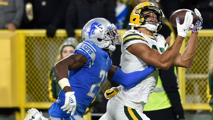 GREEN BAY, WISCONSIN - OCTOBER 14: Allen Lazard #13 of the Green Bay Packers catches a touchdown in the fourth quarter Justin Coleman #27 of the Detroit Lions at Lambeau Field on October 14, 2019 in Green Bay, Wisconsin. (Photo by Quinn Harris/Getty Images)