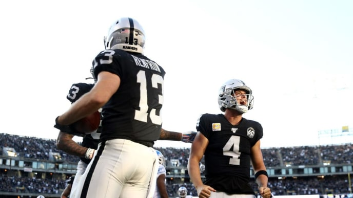 OAKLAND, CALIFORNIA - NOVEMBER 03:   Hunter Renfrow #13 of the Oakland Raiders is congratulated by Derek Carr #4 and Darren Waller #83 after he caught the winning touchdown pass against the Detroit Lions at RingCentral Coliseum on November 03, 2019 in Oakland, California. (Photo by Ezra Shaw/Getty Images)