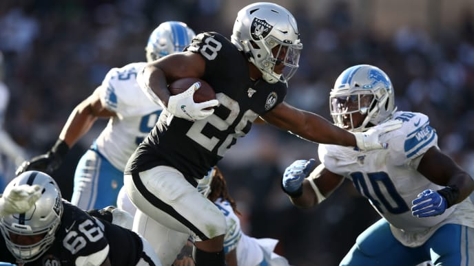 OAKLAND, CALIFORNIA - NOVEMBER 03:   Josh Jacobs #28 of the Oakland Raiders runs with the ball against the Detroit Lions at RingCentral Coliseum on November 03, 2019 in Oakland, California. (Photo by Ezra Shaw/Getty Images)