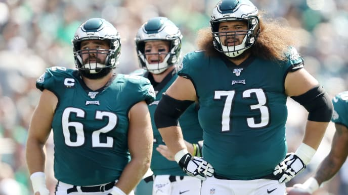 PHILADELPHIA, PENNSYLVANIA - SEPTEMBER 22: Jason Kelce #62,Carson Wentz #11 and Isaac Seumalo #73 of the Philadelphia Eagles line up before the play against the Detroit Lions at Lincoln Financial Field on September 22, 2019 in Philadelphia, Pennsylvania. (Photo by Elsa/Getty Images)