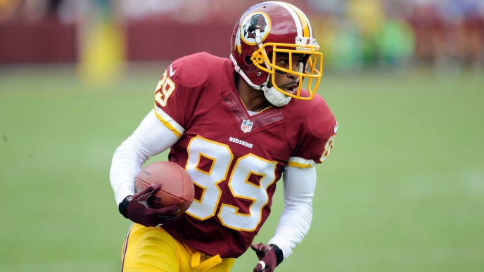 LANDOVER, MD - SEPTEMBER 22:  Santana Moss #89 of the Washington Redskins runs with the ball against the Detroit Lions at FedExField on September 22, 2013 in Landover, Maryland.  (Photo by G Fiume/Getty Images)