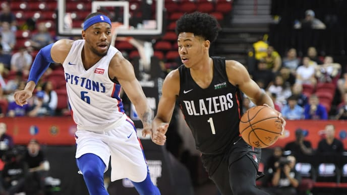 LAS VEGAS, NEVADA - JULY 06:  Anfernee Simons #1 of the Portland Trail Blazers brings the ball up the court against Bruce Brown #6 of the Detroit Pistons during the 2019 NBA Summer League at the Thomas & Mack Center on July 6, 2019 in Las Vegas, Nevada. The Pistons defeated the Trail Blazers 93-73. NOTE TO USER: User expressly acknowledges and agrees that, by downloading and or using this photograph, User is consenting to the terms and conditions of the Getty Images License Agreement.  (Photo by Ethan Miller/Getty Images)