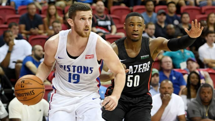 LAS VEGAS, NEVADA - JULY 06:  Sviatoslav Mykhailiuk #19 of the Detroit Pistons drives against Demetrius Jackson #50 of the Portland Trail Blazers during the 2019 NBA Summer League at the Thomas & Mack Center on July 6, 2019 in Las Vegas, Nevada. The Pistons defeated the Trail Blazers 93-73. NOTE TO USER: User expressly acknowledges and agrees that, by downloading and or using this photograph, User is consenting to the terms and conditions of the Getty Images License Agreement.  (Photo by Ethan Miller/Getty Images)