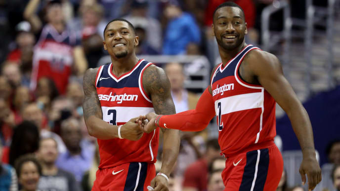WASHINGTON, DC - OCTOBER 20: Bradley Beal #3 and John Wall #2 of the Washington Wizards celebrate in the second half against the Detroit Pistons at Capital One Arena on October 20, 2017 in Washington, DC. NOTE TO USER: User expressly acknowledges and agrees that, by downloading and or using this photograph, User is consenting to the terms and conditions of the Getty Images License Agreement. (Photo by Rob Carr/Getty Images)