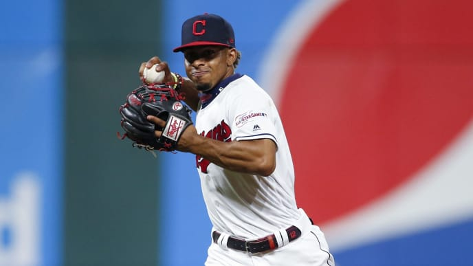 CLEVELAND, OH - JULY 16: Francisco Lindor #12 of the Cleveland Indians throws out Harold Castro #30 of the Detroit Tigers at first base during the seventh inning at Progressive Field on July 16, 2019 in Cleveland, Ohio. (Photo by Ron Schwane/Getty Images)