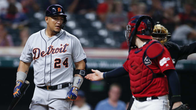 CLEVELAND, OH - JULY 15: Miguel Cabrera #24 of the Detroit Tigers talks with Roberto Perez #55 of the Cleveland Indians after being struck out by Brad Hand #33 during the ninth inning at Progressive Field on July 15, 2019 in Cleveland, Ohio. The Indians defeated the Tigers 8-6. (Photo by Ron Schwane/Getty Images)