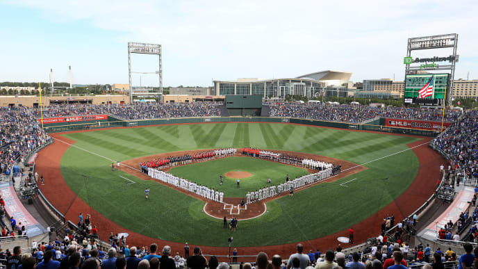 OMAHA, NEBRASKA - JUNE 13:  A general view as the players from each of the 8 College World Series teams line up with the Detroit Tigers and the Kansas City Royals during the National Anthem ahead of the game at TD America Park on June 13, 2019 in Omaha, Nebraska. (Photo by Jamie Squire/Getty Images)