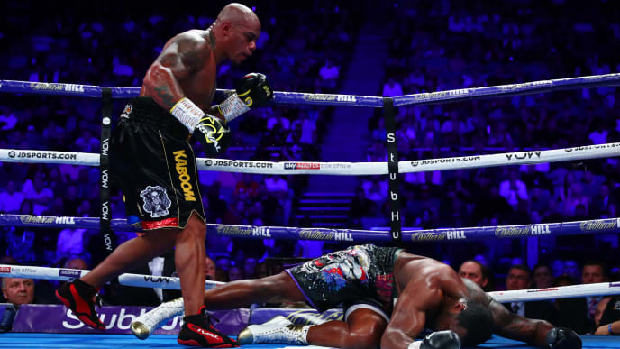 LONDON, ENGLAND - JULY 20: Dillian Whyte lays on the mat after being knocked down by Oscar Rivas in the 9th round during the WBC Interim Title and Final Eliminator for WBC World Heavyweight Title fight between Dillian Whyte and Oscar Rivas at The O2 Arena on July 20, 2019 in London, England. (Photo by Dan Istitene/Getty Images)
