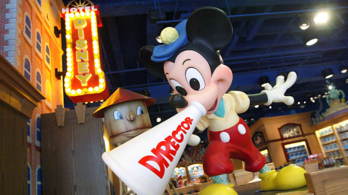 CHICAGO - MARCH 15:  Mickey Mouse as a movie director is shown in a Disney Store March 15, 2004 in Chicago, Illiinois.  Disney is still planning to sell two  money losing ventures, the Disney Stores and the Mighty Ducks hockey team.  (Photo by Tim Boyle/Getty Images)