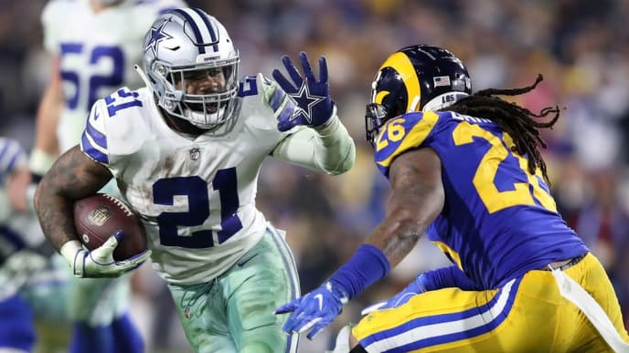 LOS ANGELES, CA - JANUARY 12: Ezekiel Elliott #21 of the Dallas Cowboys runs with the ball against Mark Barron #26 of the Los Angeles Rams in the fourth quarter in the NFC Divisional Playoff game at Los Angeles Memorial Coliseum on January 12, 2019 in Los Angeles, California.  (Photo by Sean M. Haffey/Getty Images)