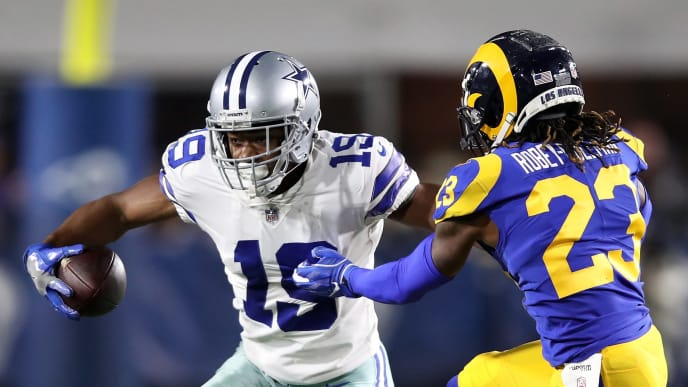 LOS ANGELES, CA - JANUARY 12:  Amari Cooper #19 of the Dallas Cowboys runs after a catch against Nickell Robey-Coleman #23 of the Los Angeles Rams in the second half in the NFC Divisional Playoff game at Los Angeles Memorial Coliseum on January 12, 2019 in Los Angeles, California.  (Photo by Sean M. Haffey/Getty Images)